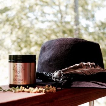CBD Pain Cream - Wild Intuitives artful pic with hat